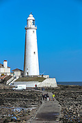 Visitors are seen to be walking around the Lighthouse tower of St. Mary's Island on Wednesday, March 17, 2021 - which is a small sandstone island near the seaside resort of Whitley Bay in the north of England. It is a Local Nature Reserve. Located in the seaside town on the northeast coast of England, it is administered as part of the borough of North Tyneside in Tyne and Wear. (Photo/ Vudi Xhymshiti)
