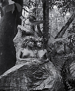 William Rickets Sanctuary - Black and white photo art print of Sculpture of Aboriginal children in the deep woodland of the Dandenon Mountain near Melbourne Australia. Taken 1993 by Paul Williams,