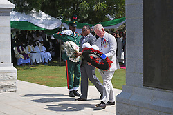 The Prince of Wales lays a wreath as he attends a service of commemoration at the Abuja Memorial, Nigerian National Military Cemetery, in Abuja Nigeria, on the final day of his trip to west Africa with the Duchess of Cornwall.