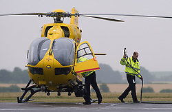 The Duke of Cambridge after refuelling his helicopter as he begins his new job with the East Anglian Air Ambulance (EAAA) at Cambridge Airport.