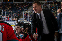 KELOWNA, BC - DECEMBER 18: Kelowna Rockets head coach Adam Foote fist bumps Trevor Wong #8 on the bench against the Vancouver Giants at Prospera Place on December 18, 2019 in Kelowna, Canada. (Photo by Marissa Baecker/Shoot the Breeze)