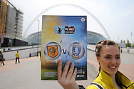a Programme seller selling the official match day programme outside Wembley Stadium before k/o. Skybet football league Championship play off final match, Hull city v Sheffield Wednesday at Wembley Stadium in London on Saturday 28th May 2016.<br /> pic by John Patrick Fletcher, Andrew Orchard sports photography.