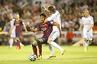 Real Madrid´s Coentrao (R) and F.C. Barcelona´s Neymar Jr during the Spanish Copa del Rey `King´s Cup´ final soccer match between Real Madrid and F.C. Barcelona at Mestalla stadium, in Valencia, Spain. April 16, 2014. (ALTERPHOTOS/Victor Blanco)