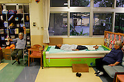 At a senior center in the small city of Nago, Okinawa, elderly Japanese can spend the day in a setting reminiscent of a spa, taking footbaths, enjoying deep-water massage, and lunching with friends. With their caring, community-based nursing and assistance staff, Okinawan nursing homes and senior daycare centers, both public and private, seem wondrous places (vibrant and lively) where friends gather for foot massages, water volleyball, haircuts, or simple meals. (Supporting image from the project Hungry Planet: What the World Eats)