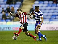 Luke Freeman of Sheffield Utd tacked by Andy Rinomhota of Reading during the FA Cup match at the Madejski Stadium, Reading. Picture date: 3rd March 2020. Picture credit should read: Simon Bellis/Sportimage