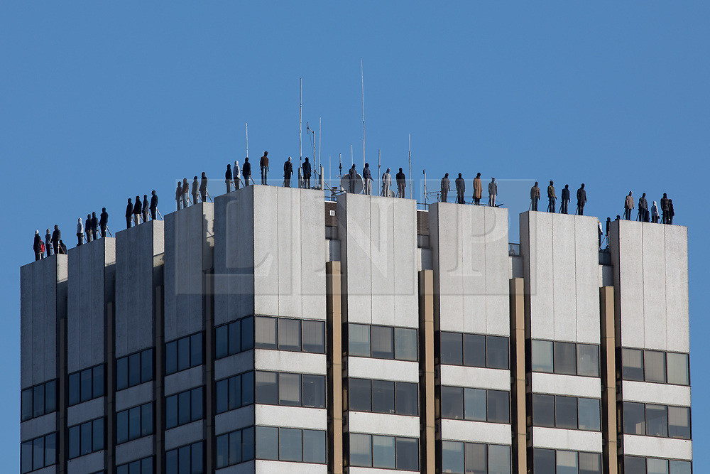 © Licensed to London News Pictures. 26/03/2018. London, UK. EMBARGOED UNTIL 10:30AM 26/03/18. 84 sculptures of men are seen atop of the ITV studios on the South Bank of London, as part of a campaign against male suicide. The installation, titled #Project84 and organised by the Campaign Against Living Miserably (CALM) was created by sculptor Mark Jenkins, and represents the number of men in the UK who die by suicide every week - one life lost every two hours. Photo credit : Tom Nicholson/LNP