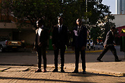 Patrick Olela Ayot, Bernard Kamangu and Albert Kimani walk through the Central Business District of Nairobi, Kenya on Monday 16th of September.