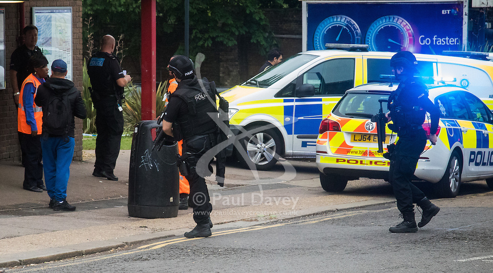 """Kensal Green, London, May 31st 2016. Police in body armoured protective headgear seal off Kensal Green tube station in North West London in what is described as a """"security incident"""". PICTURED: Armed officers enter the station"""