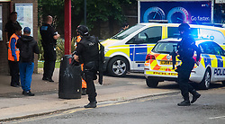 "Kensal Green, London, May 31st 2016. Police in body armoured protective headgear seal off Kensal Green tube station in North West London in what is described as a ""security incident"". PICTURED: Armed officers enter the station"