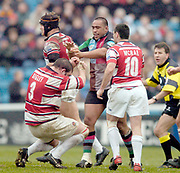 2004/05 Zurich Premiership,NEC Harlequins vs Gloucester, The Stoop,Twickenham, ENGLAND:<br /> Gloucester's Terry Sigley, sink's to his knees after receiving a strike from Quins Ace Tiatia<br /> <br /> Twickenham. Surrey, UK., 5th February 2005, Zurich Premiership Rugby,  The Stoop,  [Mandatory Credit: Peter Spurrier/Intersport Images],
