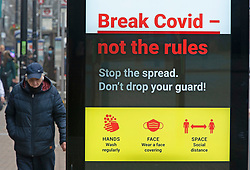© Licensed to London News Pictures 03/03/2021. <br /> Bromley, UK. Coronavirus advertising. People out and about in Bromley High Street in South East London today during a third national coronavirus lockdown. Non-essential shops could open in weeks if the Covid-19 infection rate keeps dropping. Photo credit:Grant Falvey/LNP