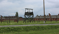 A guard tower and barracks at the Auschwitz-Birkenau Nazi concentration camps in Auschwitz, Poland on September 3, 2017. Auschwitz concentration camp was a network of German Nazi concentration camps and extermination camps built and operated by the Third Reich in Polish areas annexed by Nazi Germany during WWII. It consisted of Auschwitz I (the original camp), Auschwitz II–Birkenau (a combination concentration/extermination camp), Auschwitz II–Monowitz (a labor camp to staff an IG Farben factory), and 45 satellite camps. In September 1941, Auschwitz II–Birkenau went on to become a major site of the Nazi Final Solution to the Jewish Question. From early 1942 until late 1944, transport trains delivered Jews to the camp's gas chambers from all over German-occupied Europe, where they were killed en masse with the pesticide Zyklon B. An estimated 1.3 million people were sent to the camp, of whom at least 1.1million died. Around 90 percent of those killed were Jewish; approximately 1 in 6 Jews killed in the Holocaust died at the camp. Others deported to Auschwitz included 150,000 Poles, 23,000 Romani and Sinti, 15,000 Soviet prisoners of war, 400 Jehovah's Witnesses, and tens of thousands of others of diverse nationalities, including an unknown number of homosexuals. Many of those not killed in the gas chambers died of starvation, forced labor, infectious diseases, individual executions, and medical experiments. In 1947, Poland founded a museum on the site of Auschwitz I and II, and in 1979, it was named a UNESCO World Heritage Site. Photo by Somer/ABACAPRESS.COM