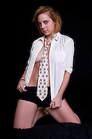 Sensual woman with shirt and tie doing a striptease