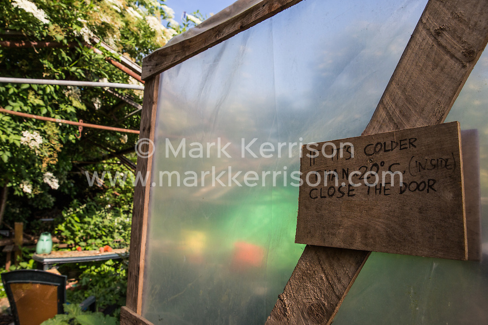 Sipson, UK. 5th June, 2018. A door to a poly tunnel is pictured at Grow Heathrow. Grow Heathrow is a squatted off-grid eco-community garden founded in 2010 on a previously derelict site close to Heathrow airport to rally support against government plans for a third runway and it has since made a significant educational and spiritual contribution to life in the Heathrow villages, which remain threatened by Heathrow airport expansion.