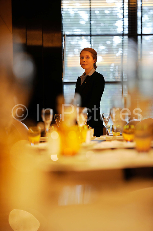 """Waitress in one of the Savoy Hotel's restaurants. The iconic hotel reopened after a three year refit that cost £220 million ($350 million). The Savoy Hotel is a located on the Strand, in central London. Built by impresario Richard D'Oyly Carte the hotel opened on 6 August 1889. It was the first in the Savoy group of hotels and restaurants owned by Carte's family for over a century. It has been called """"London's most famous hotel"""" and remains one of London's most prestigious and opulent hotels, with 268 rooms and panoramic views of London."""