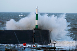 © Licensed to London News Pictures. 17/01/2018. Aberystwyth, UK. The leading edge of Storm Fionn's gale force winds bring huge waves crashing in to the sea defences in Aberystwyth, on the Cardigan Bay coast of west wales at first light today.  The storm has been named by the Irish Met office .Photo credit: Keith Morris/LNP