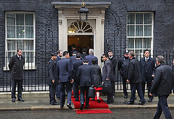 © Licensed to London News Pictures. 21/10/2015. London, UK. The Chinese entourage follow Prime Minister David Cameron and Chinese President Xi Jinping into Downing Street. Photo credit: Peter Macdiarmid/LNP