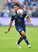 May 16, 2021 - Kansas City, KS, United States:   Sporting Kansas City midfielder Roger Espinoza (15) looks for an open teammate as he moves towards the bouncing ball. Sporting KC beat the Vancouver Whitecaps FC 3-0 in a Major League Soccer game. <br /> Photo by Tim Vizer/Polaris
