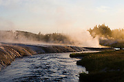Geyser and geothermal activity at sunrise along the Little Firehole River in Yellowstone National Park, Wyoming.