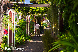 A gardener sweeps the cobbled pathways in the subtropical gardens of the Quinta Jardins da Lago hotel in Funchal, Madeira. MADEIRA, September 25 2018. © Paul Davey