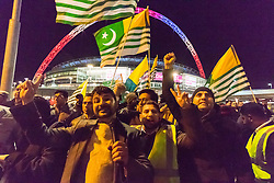 Amid high security measures, hundreds of Kashmiri protesters, supported by George Galloway, demonstrate outside Wembley Stadium ahead of an address to more than 60,000 Indian expats by Prime Minister Narendra Modi at a 'UK Welcomes Modi' reception. Modi, a Hindu and his BJP party are accused of a wide range of human rights abuses against religious and ethnic minorities in India. PICTURED: Kashmiris demonstrate outside the stadium.