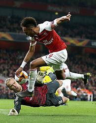 Arsenal's Pierre-Emerick Aubameyang (right) takes a shot on goal