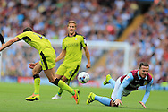 Ross McCormack of Aston Villa ® is tackled by Dominic Ball of Rotherham Utd (l). EFL Skybet championship match, Aston Villa v Rotherham Utd at Villa Park in Birmingham, The Midlands on Saturday 13th August 2016.<br /> pic by Andrew Orchard, Andrew Orchard sports photography.