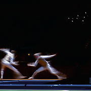 A blur of motion as Alexey Cheremisinov, Russia, (left) competes with Alexander Massialas, USA in the Men's Foil Individual event during the Fencing competition at ExCel South Hall during the London 2012 Olympic games. London, UK. 31st July 2012. Photo Tim Clayton
