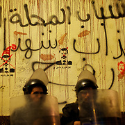 December 11, 2012 - Cairo, Egypt: Egyptian National Police takes guard at the presidential palace in Cairo where tens of thousands gather outside to voice their anger at the planned constitution, which will be put to a referendum next Saturday...The Egyptian army has reportedly called talks between President Mohamed Morsi and the opposition to end violent protests against a draft constitution...Sporadic clashes between supporters and opponents of president Mohamed Morsi, erupted in the past week over his assumption of extraordinary powers and the scheduling of the referendum. (Paulo Nunes dos Santos/Polaris)