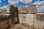 Stone wall of temple, Hattusa (also Ḫattuša or Hattusas) late Anatolian Bronze Age capital of the Hittite Empire. Hittite archaeological site and ruins, Boğazkale, Turkey.
