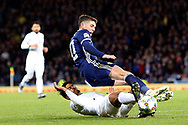 Scotland midfielder Ryan Christie (10) (Celtic) is brought down by Dor Peretz (11) (Maccabi Tel Aviv)of Israel during the UEFA Nations League match between Scotland and Israel at Hampden Park, Glasgow, United Kingdom on 20 November 2018.
