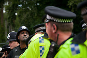 Police lines outside the Cuadrilla drill site main gate. Thousands turned out for a march of solidarity against fracking in Balcombe. The village Balcombe in Sussex is the  centre of fracking by the company Cuadrilla. The march saw anti-fracking movements from the Lancashire and the North, Wales and other communities around the UK under threat of gas and oil exploration by fracking.