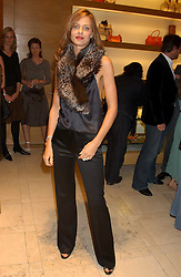 "TRINNY WOODALL at a party hosted by Christopher Bailey to celebrate the launch of ""The Snippy World of New Yorker Fashion Artist Michael Roberts"" held at Burberry, 21-23 New Bond Street, London on 20th September 2005.<br />