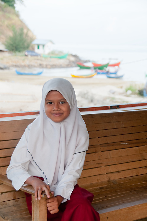 Indonesia, Sumatra, Aceh. Young Muslim girl from a small fishing village in Aceh.