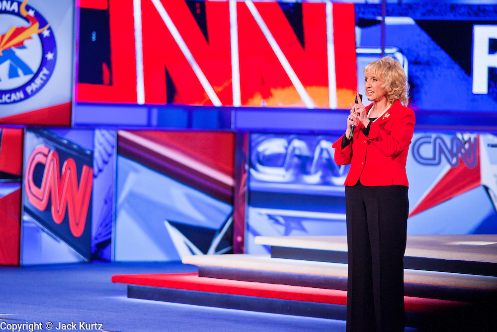 """22 FEBRUARY 2012 - MESA, AZ:   Arizona Governor JAN BREWER talks to the crowd at the Arizona Republican Presidential Debate in the Mesa Arts Center in Mesa, AZ, Wednesday. It is the last debate before the Michigan and Arizona Republican primaries on Feb. 28 and """"Super Tuesday"""" on March 6.         PHOTO BY JACK KURTZ"""