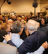 5/1/04 Omaha, Neb. Warren Buffett poses for photos with fans at the Berkshire Hathaway shareholders meeting at Qwest Center Omaha Saturday morning. (Photo by chris machian)