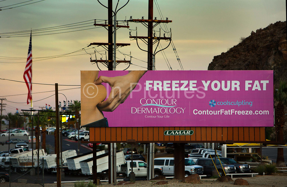 Billboard for plastic surgery, Palm Springs, California. The CoolSculpting advertised is a non-surgical procedure that uses a controlled device to freeze and destroy fat. Two out of every three Americans are considered to be overweight or obese.