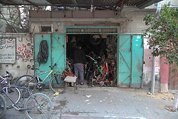 June 5, 2017 - Gaza, Palestine - Under the conditions of siege, restrictions and lack of opportunities, the young man Mohammed Karsua 25 Year, from Jabaliya refugee camp, began to open his own project in repair and sale of bicycles, and at the beginning of each new day he began a long working day to save his expenses and build his future. (Credit Image: © Ramez Habboub/Pacific Press via ZUMA Wire)