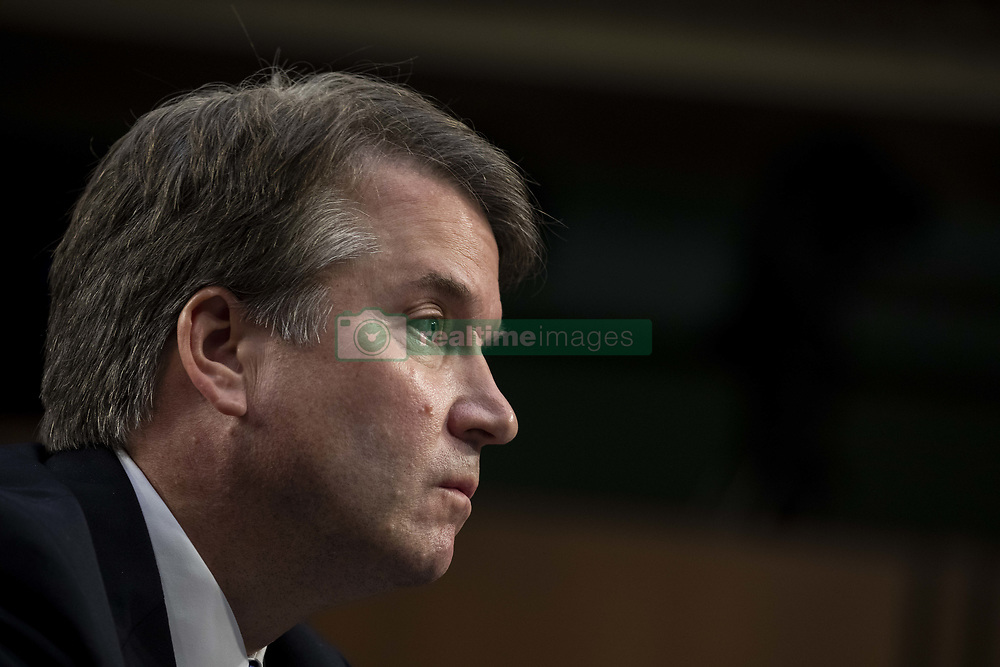 September 4, 2018 - Washington, District of Columbia, U.S. - Judge BRETT KAVANAUGH looks on as Democrats and Republicans debate during a hearing before the United States Senate Judiciary Committee on his nomination as Associate Justice of the US Supreme Court to replace the retiring Justice Anthony Kennedy on Capitol Hill. (Credit Image: © Alex Edelman/CNP via ZUMA Wire)