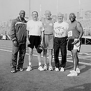"Senior athletes from ""Team Ohio"" pose for a photo before competing in the track and field competition at the 2007 Senior Olympics, held at the University of Louisville's Cardinal Park Soccer & Track Stadium in Louisville, Kentucky on June 28, 2007. ..The athletes are, from left, Malachi McGruder, 65, Jim Ballinger, 68, John Corbet, 74, Bob Shoemaker, 67 and Tom Johnson, 66. ..The event was sponsored by the National Senior Games Association, established in 1986, which oversees 50 state and 350 local and regional competitions for senior athletes in the United States each year. There are an estimated 250,000 senior athletes in training in the U.S. ..."