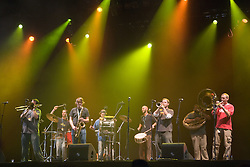 Members of Youngblood Brass Band playing a wind instruments and drums on stage at the WOMAD (World of Music; Arts and Dance) Festival in reading; 2005,