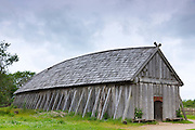 Historic viking longhouse reconstruction with oak shingles roof at Ribe Viking Center, heritage centre in South Jutland, Denmark