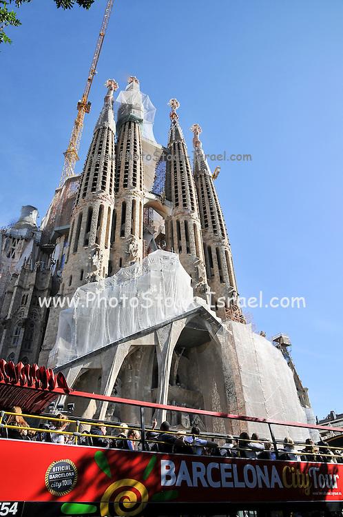 La Sagrada Familia, a major tourist attraction in Barcelona, Catalonia, Spain. A Barcelona city tour bus in front of this landmark