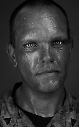 Cpl. Glenn Mefford, 29, Sacramento, California, Headquarters Platoon, Kilo Co., Third Battalion First Marines, United States Marine Corps, at the company's firm base in Hit, Iraq on Monday Sept. 19, 2005.
