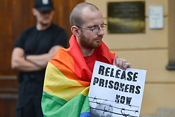 August 7, 2017 - Krakow, Poland - A protestor holds 'Release Prisoners Now' sign during 'Krakow in Solidarity with All Imprisoned in Hamburg' protest, in front of the German Consulate in Krakow..On Monday, August 7, 2017, in Krakow, Poland. (Credit Image: © Artur Widak/NurPhoto via ZUMA Press)
