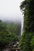 The second Chute du Carbet waterfall as seen on a foggy day in the rainforests of Guadeloupe French Caribbean