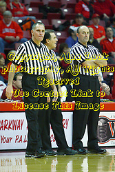 30 January 2011: Referees Kelly Self, Tom O'Neill, and Rick Randall during an NCAA basketball game between the Drake Bulldogs and the Illinois State Redbirds. The Redbirds win in OT 77-75 after a last three point shot by Drake was ruled too late at Redbird Arena in Normal Illinois.