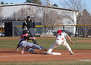 Coconino's third baseman, Marcus Romo, applies the tag to Bradshaw Mountain High's Steven Hernandez as he attempts to steal third base. Hernandez would be called safe since Romo received a high throw and was only a fraction of a second from beating Hernandez to the bag. (Photo by David Carballido-Jeans)
