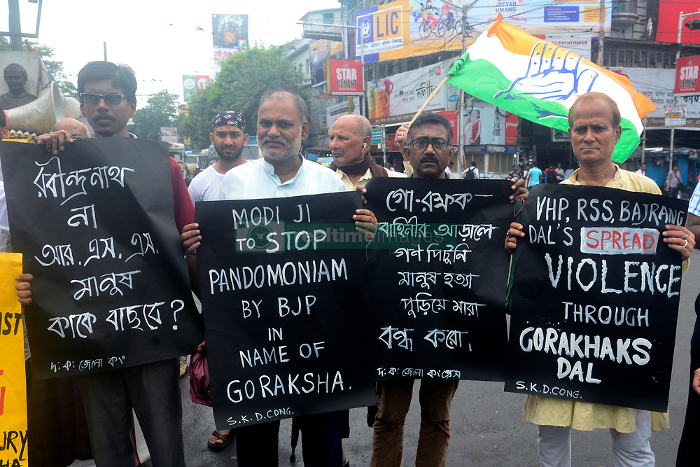 South Kolkata District Congress protests against suspension of Congress five Member of Parliament including Adhir Ranjan Chowdhury and also burn effigy of Prime Minister Narendra Modi during this agitation. (Photo by Saikat Paul / Pacific Press) *** Please Use Credit from Credit Field ***