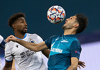 SAINT-PETERSBURG, RUSSIA - OCTOBER 20: Emmanuel Dennis of Club Brugge KV and Sardar Azmoun of Zenit St Petersburg during the UEFA Champions League Group F match between Zenit St Petersburg and Club Brugge KV at Gazprom Arena on October 20, 2020 in Saint-Petersburg, Russia [Photo by MB Media]